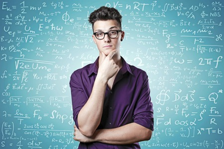Closeup portrait of a young genius man confused on background with algebra