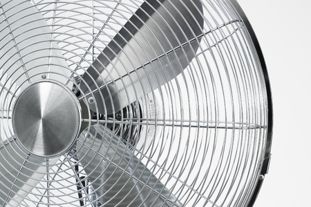 air cooler chrome Metal fan on a white background with spinning blades during summer period.
