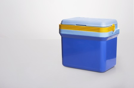 ice chest: a beautiful  blue cooler with a yelllow handle on a white background.