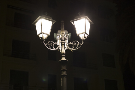 street lamp: old lamp posts above city Stock Photo