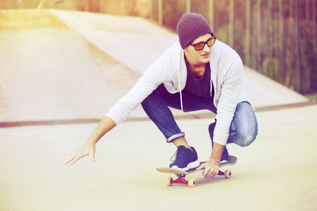 happy teens: Teen boy riding skateboard with effect colors Stock Photo