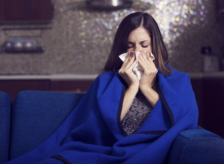 coughing: Sick young woman is coughing and blowing. Stock Photo