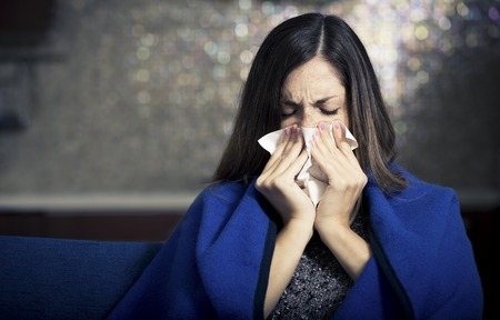 coughing: Sick young woman is coughing and blowing..