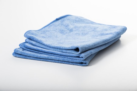 wash car: Microfiber towel for car wipe. Stock Photo