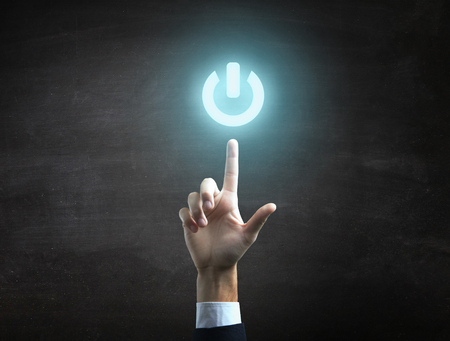 beautiful Business male hand indicating power on icon.