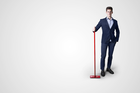 cleaning debt: business man cleaning with mop
