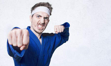 convinced: funny nerd trying some martial arts poses.