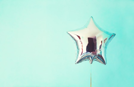 star balloon of success on colorful background. Archivio Fotografico