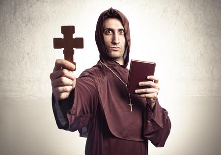 religious habit: blessing friar on background and religious  habit Stock Photo