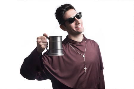 droll: funny friar with beer mug on background