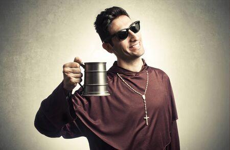 friar: funny friar with beer mug on background
