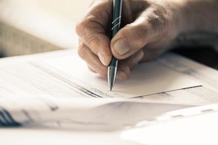 soft focus pen writing.