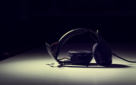 destroyed headphones on background. Фото со стока