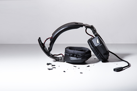 destroyed headphones on background. Stock Photo
