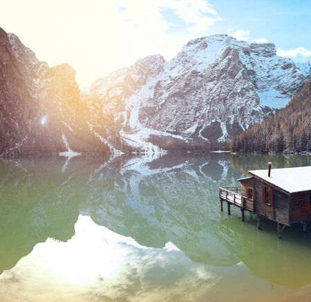 winter sunrise with colorful cloudscape over Lago di Braies, Dolomites, Italy.