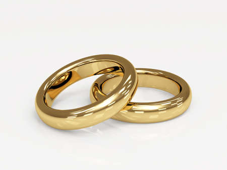 vows: Two 3d gold wedding ring, laying on a glossy surface Stock Photo