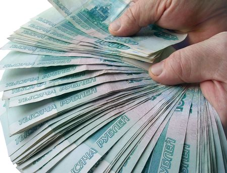 representing: The hands holding many of the Russian banknotes
