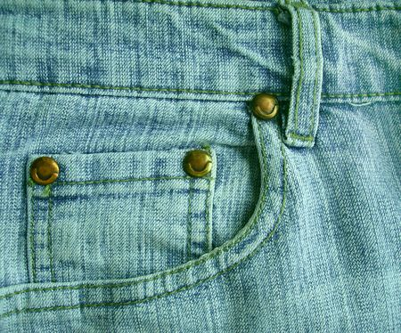 Background a jeans pocket with metal buttons photo