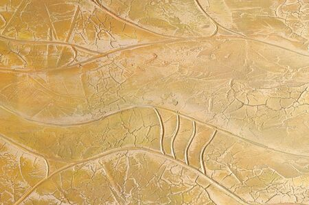 yellow  ochre: Texture of stucco. A wall covered with relief stucco