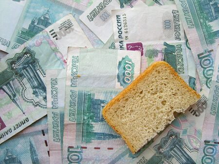 transferable: Piece of bread laying on banknotes of Russia Stock Photo