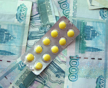 transferable: The yellow tablets laying on the Russian banknotes Stock Photo