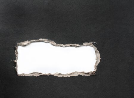 fragmentary: Hole with the fragmentary edges, punched in a cardboard Stock Photo