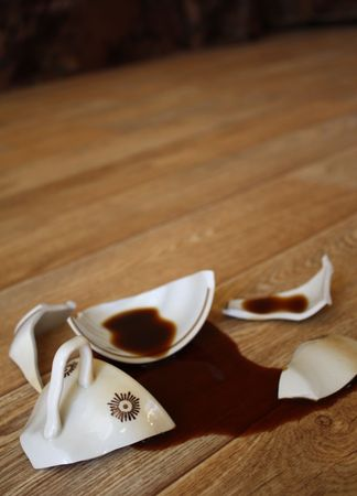 Coffee, flowed out from the broken cup photo