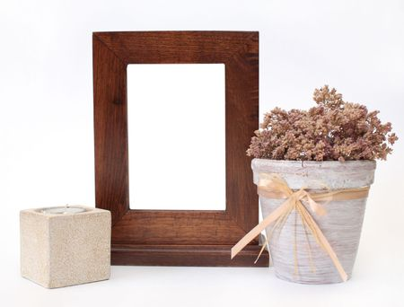 Wooden frame, candlestick and flower pot. Object over white photo