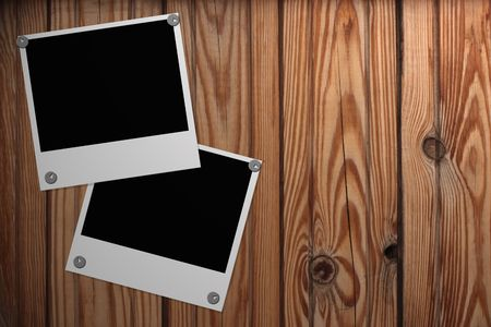 Grunge wooden background with two blank photos photo