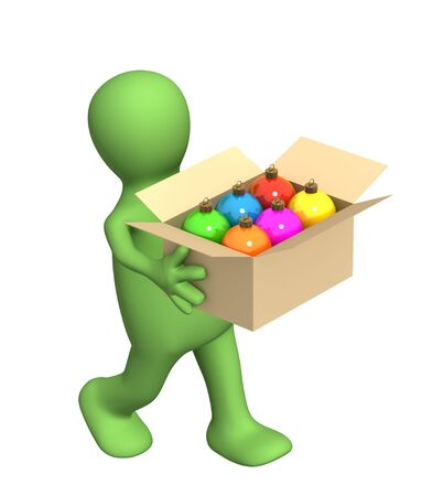 carrying box: Puppet, carrying a box with christmas balls Stock Photo