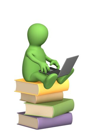 literary man: Puppet with a laptop on pile books Stock Photo