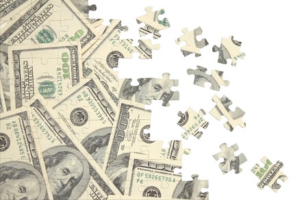 perplexing: Background from a puzzle with the image of dollars Stock Photo