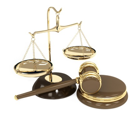 Gold scales and auction hammer. Objects over white photo