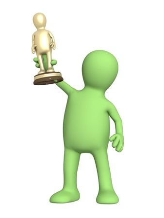 exhilaration: Award - puppet with a gold figurine Stock Photo