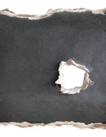 Hole with the fragmentary edges, punched in a cardboard Stock Photo