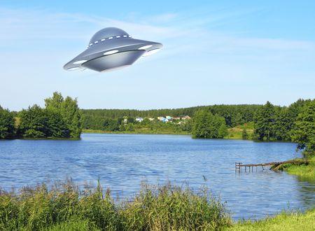 UFO flying above lake Stock Photo - 5669120