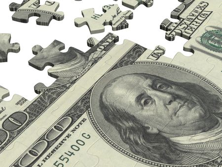 Collected puzzle with the image of dollars photo