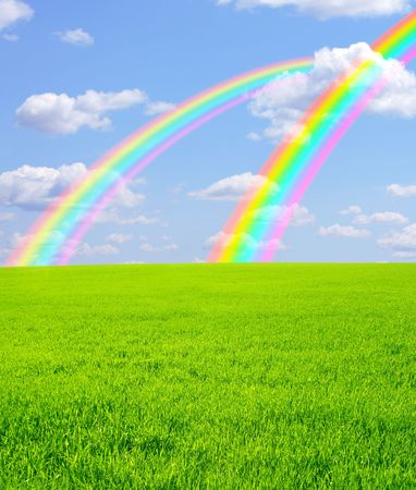 Beautiful bright rainbows in the blue sky photo