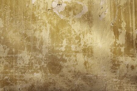 yellow  ochre: Grunge background - texture stucco of ochre color Stock Photo