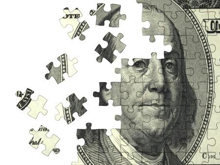 schuld: Verzamelde puzzel met het beeld van de dollar