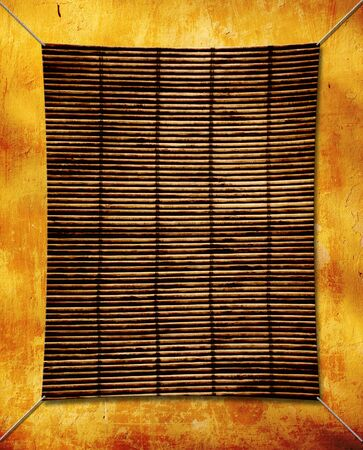 Grunge background with bamboo mat photo