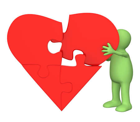 Symbol of love - heart from parts of a puzzle Stock Photo - 7715322