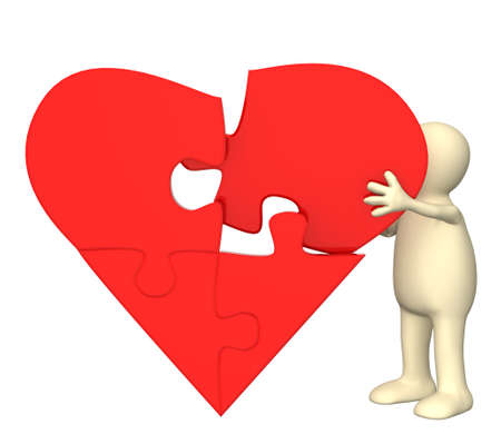 Symbol of love - heart from parts of a puzzle photo
