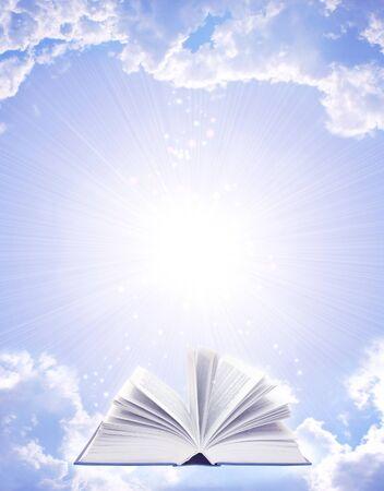 opened book: Magic book and sun in blue sky Stock Photo