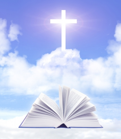 Bible and cross on cloud