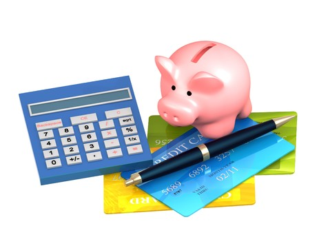 Piggy bank, credit card and calculator. Isolated over white photo