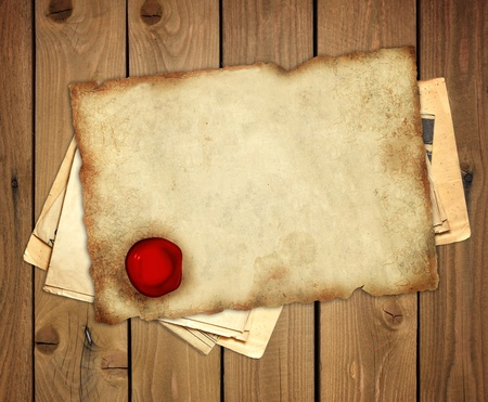 Old parchment with wax sea on wooden boards Stock Photo - 8321021