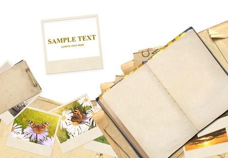 Frame with old paper and photos. Objects isolated over white photo