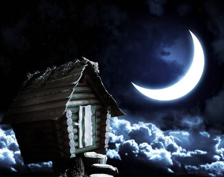 Dark series - witches hut and moon Stock Photo - 8814914