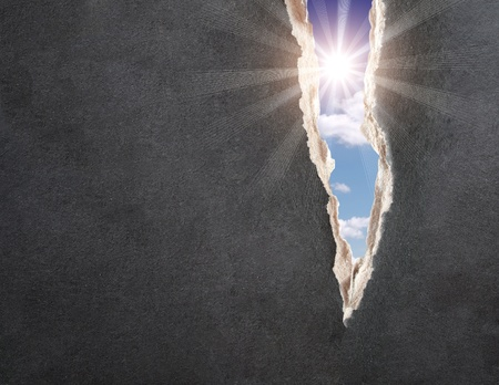 impacts: Sun and blue sky in hole with the fragmentary edges